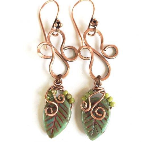 My new leaf falljewelry copper spiral earrings patina boho shoulderdustershellip